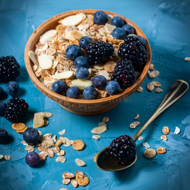 Granola with blueberries and blackberries. Healthy food. Selective focus stock images