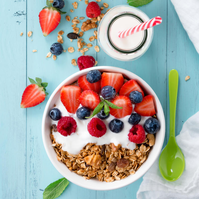 Granola breakfast with berries royalty free stock images