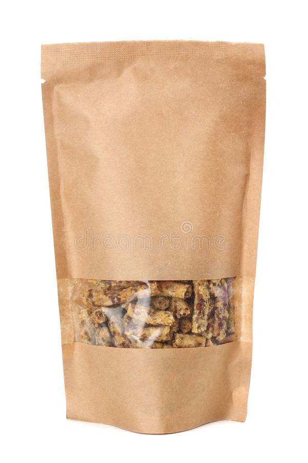 Granola breakfast in kraft paper bag isolated on white background. muesli. healthy food. fitness food royalty free stock images