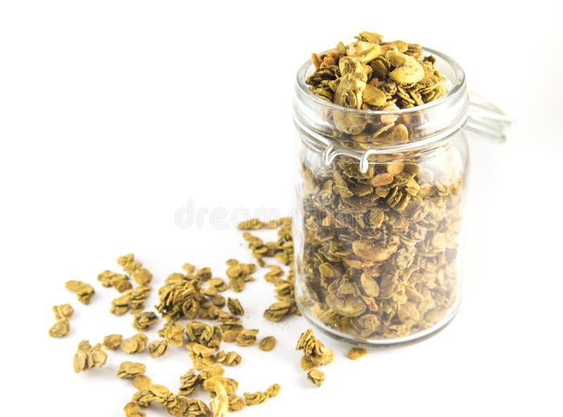 Granola fresco del desayuno sano, muesli en un tarro de cristal Semillas orgánicas de la avena, de la almendra y de girasol foto de archivo libre de regalías