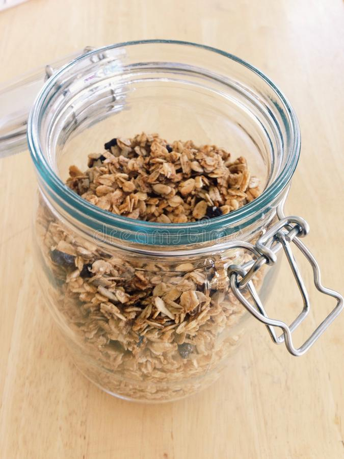 Granola in a glass jar royalty free stock photos