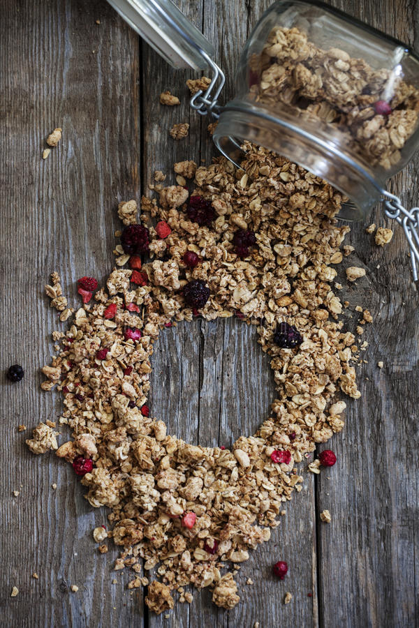 Granola. In glass jar on wooden background stock image