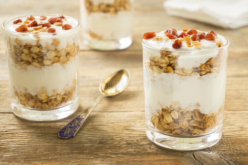 Granola in glasses with yoghurt. And pomegranate stock photography