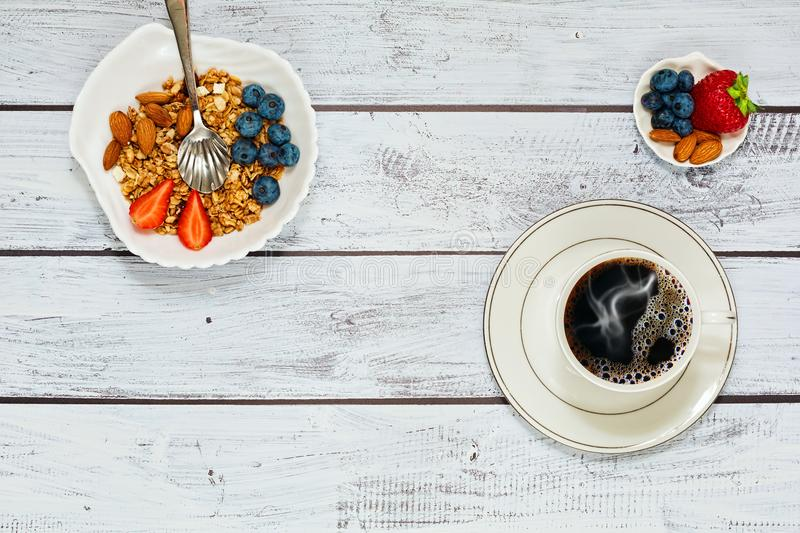 Granola healthy breakfast with coffee royalty free stock images