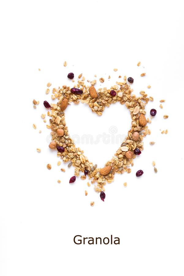 Granola Heart. Granola in shape of Heart, creative layout isolated on white background, copy space stock photography