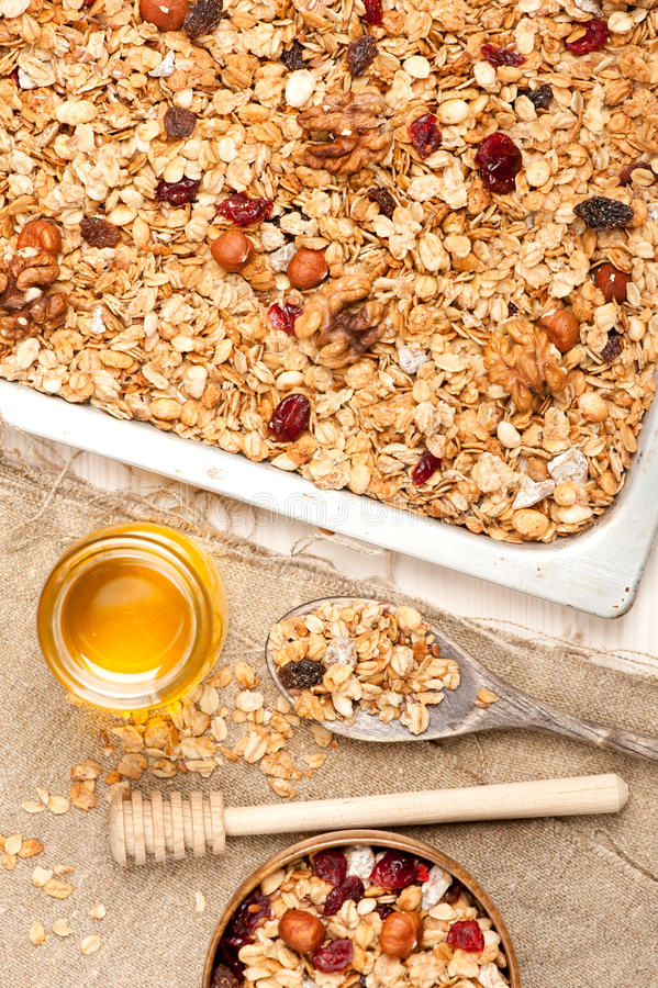Granola with honey, dried fruit and nuts. Granola with dried fruits, honey and nuts. See series stock photography