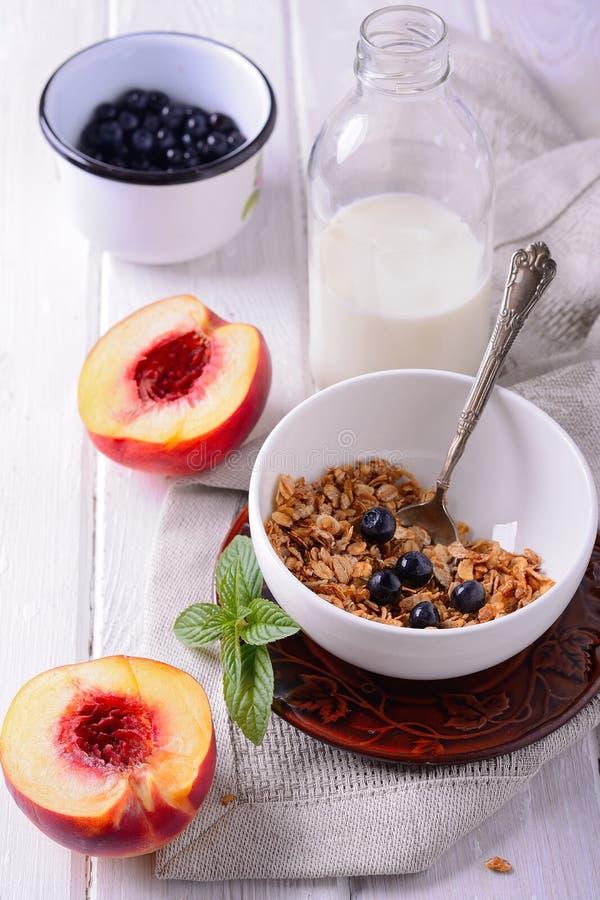 Granola and oat mash with fresh blueberries,. Granola and oat mash with fresh organic blueberries, nectarines stock image