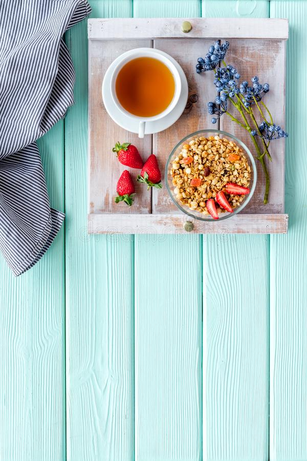 Free Granola With Fruit, Cup Of Tea For Breakfast In Bed On Mint Green Wooden Background Top View Space For Text Royalty Free Stock Images - 153425069