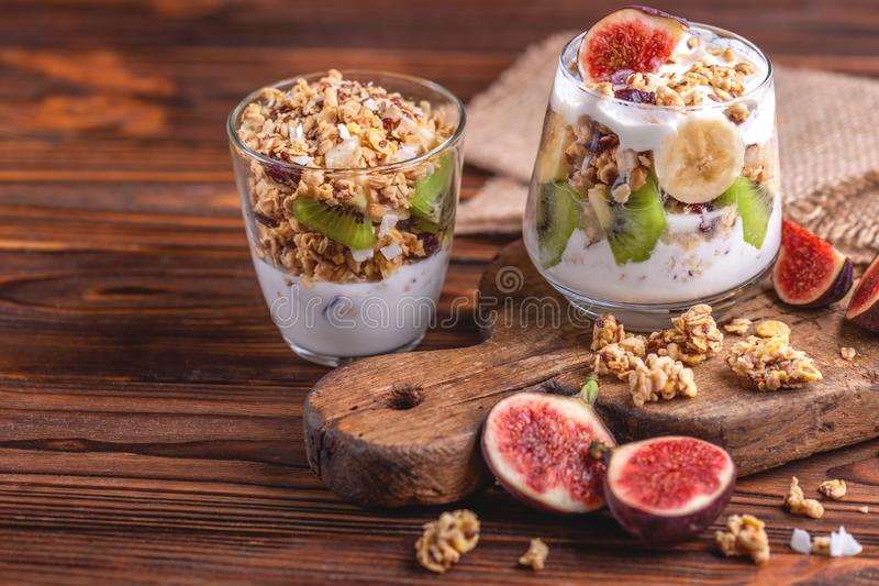 Granola with yogurt, bananas and figs. Copy space stock images