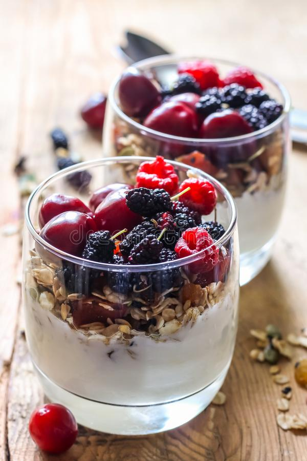 Granola with yogurt and berries. In a glass. Delicious healthy American food for breakfast. Traditional US snack. Selective focus royalty free stock images