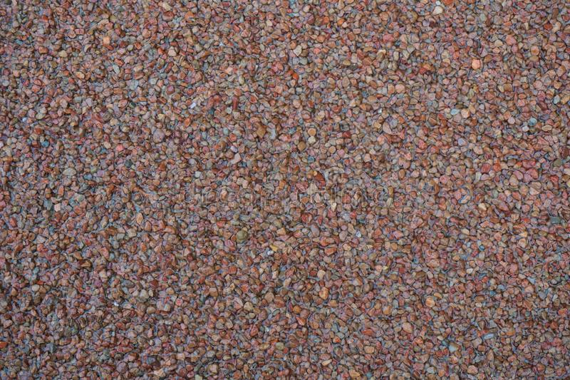 Granos de arena rojos para el fondo o la textura fotografía de archivo libre de regalías