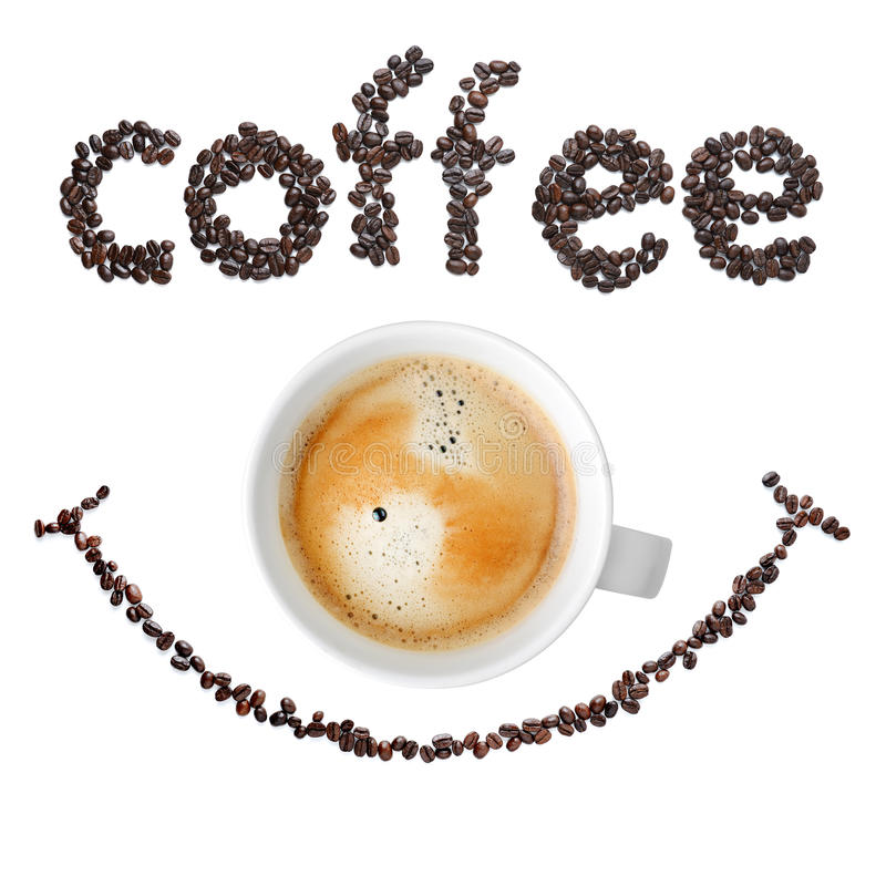 Granos de café con la taza de café imagen de archivo