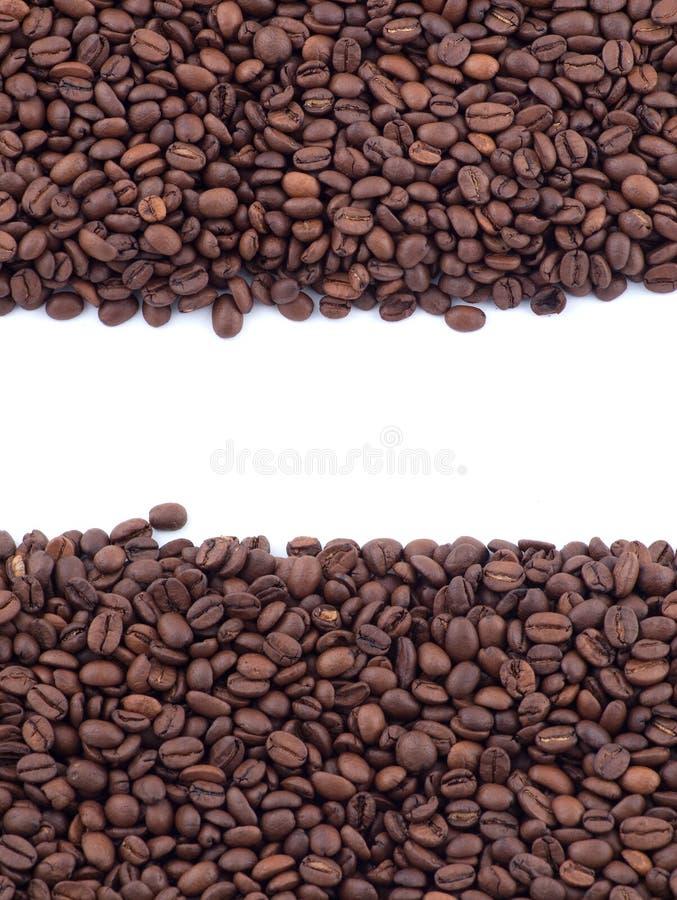 Granos de café derramados foto de archivo