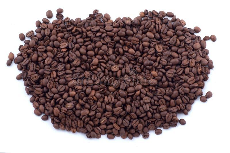 Granos de café derramados imagen de archivo
