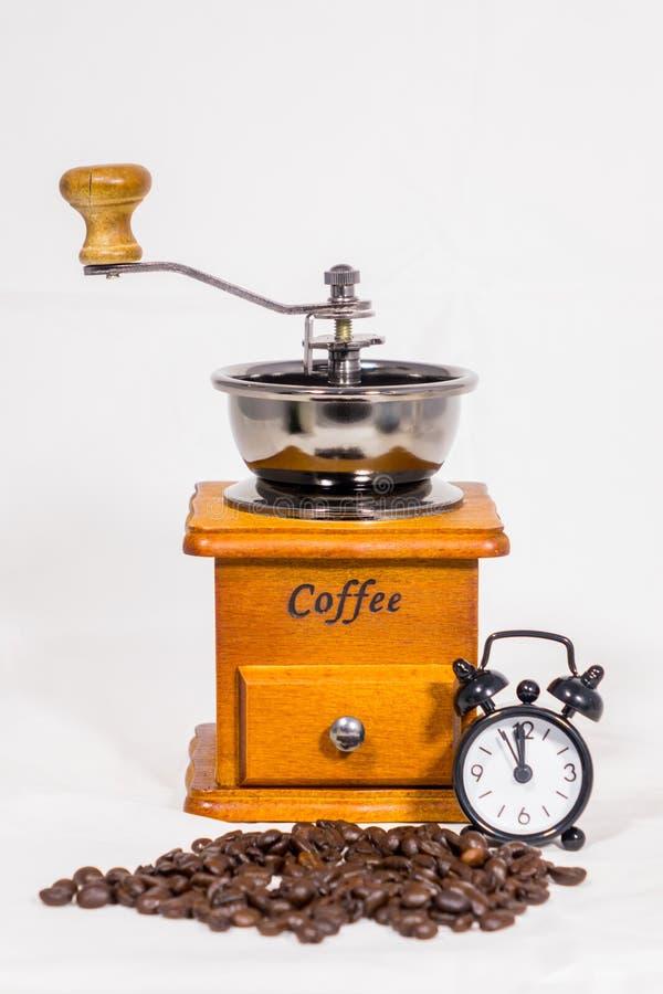 Granos de café, despertadores, amoladora de café fotografía de archivo libre de regalías