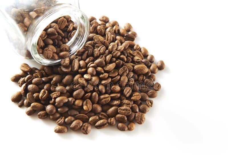 Granos de café en botella imagen de archivo