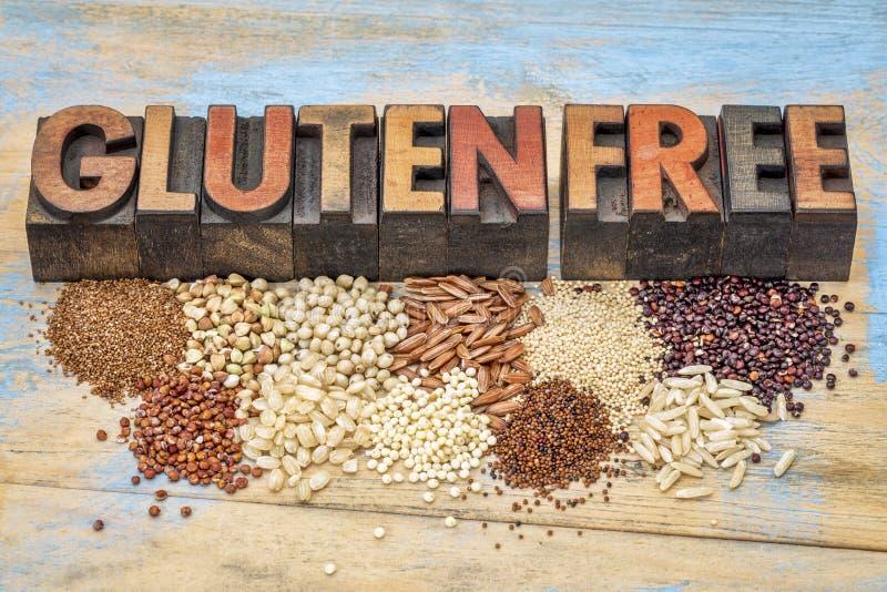 Granos libres y tipografía del gluten foto de archivo