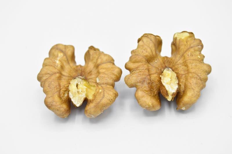 Granos marrones beige sanos y nutritivos de la nuez fotos de archivo