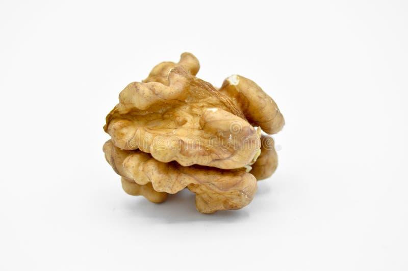 Granos marrones beige sanos y nutritivos de la nuez fotografía de archivo libre de regalías