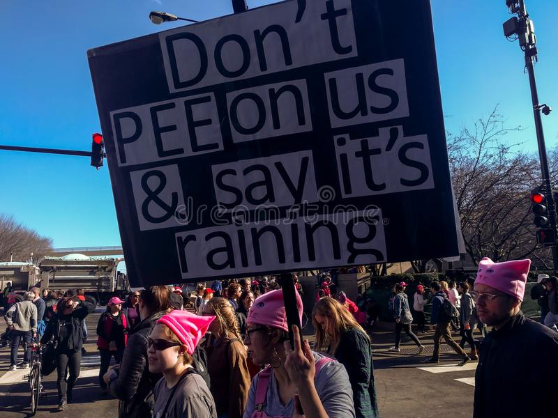 Women`s March in Chicago. `Don`t pee on us...` poster. stock photo