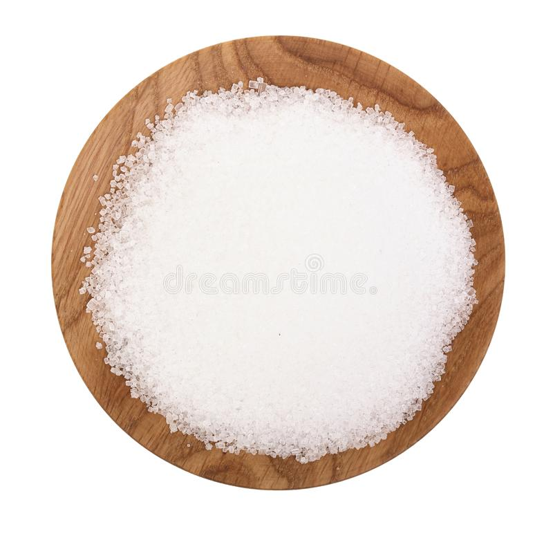 Granulated sugar in wooden bowl isolated on white background. Top view. Flat lay.  royalty free stock photo