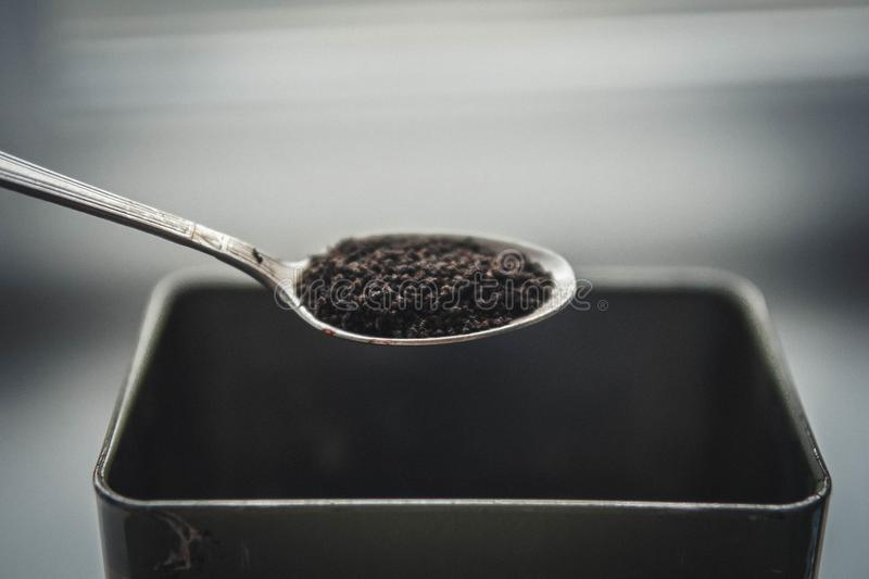 Granules dry black tea royalty free stock photography
