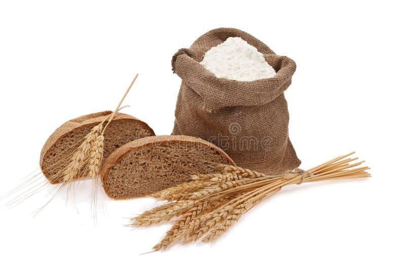 Granulo del frumento e della farina con pane fotografia stock