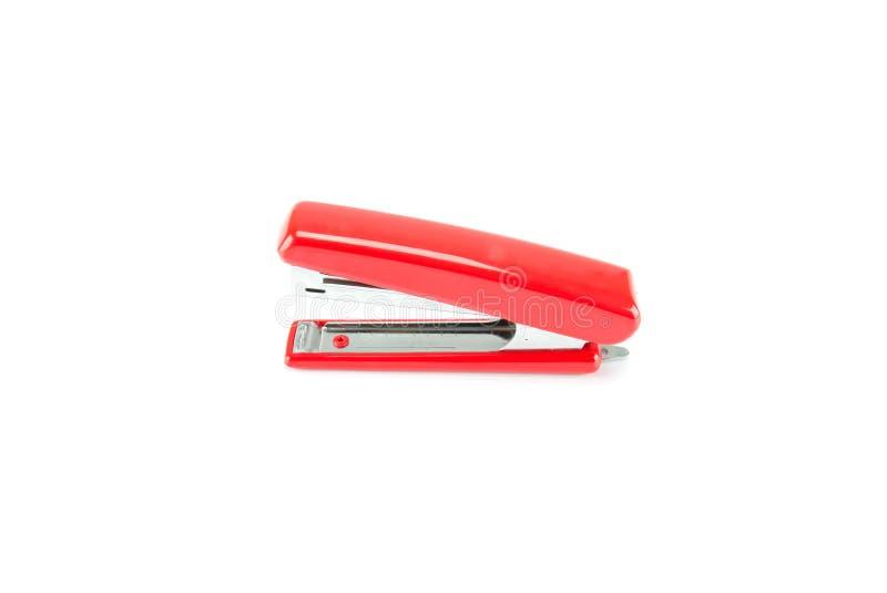 Grapadora roja en el fondo blanco fotos de archivo libres de regalías