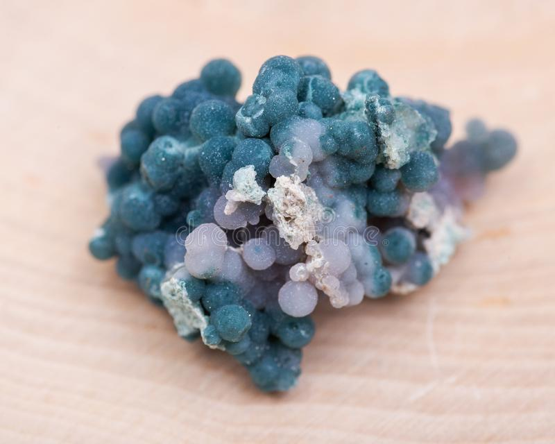 Grape Agate Clusters from Indonesia isolated on natural wood stock image