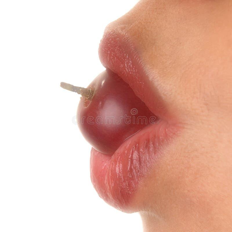 Grape eating stock image