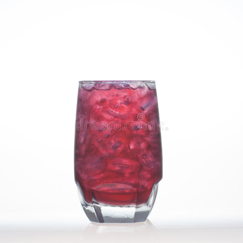 Grape flavour aerated drinks whit soda and ice in glass. On white background stock photos