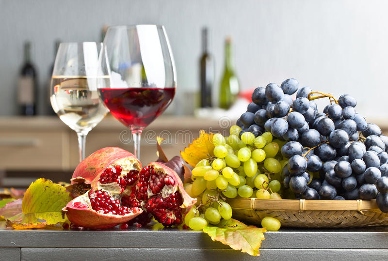 Grape and glass of wine stock image