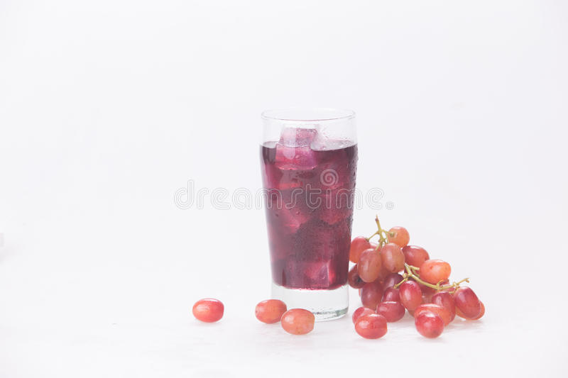 Grape juice in a glass with ice. Juice in wine glasses with ice on the white background stock photography