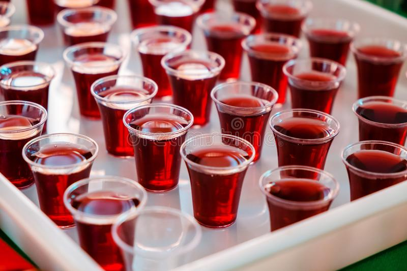 Grape juice in the Plastic cups for Holy Communion in the Church royalty free stock images