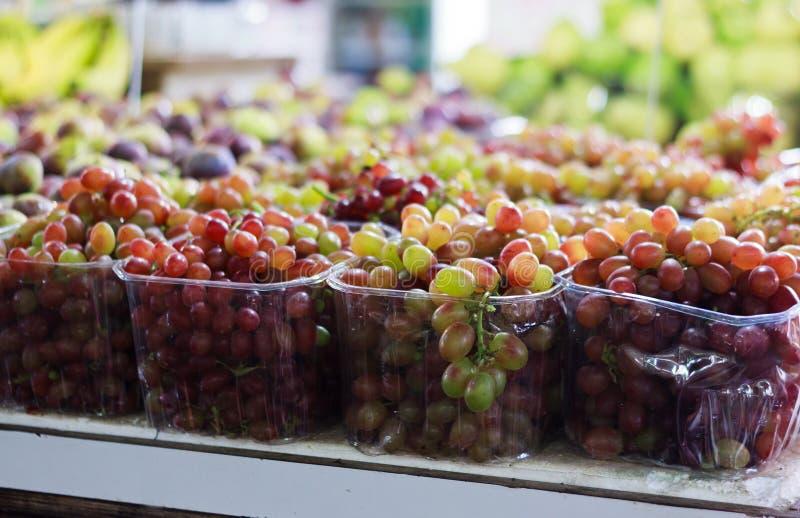 Grape in plastic packs stock photos