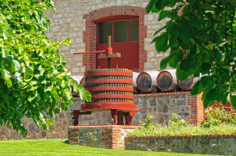 Grape press - Barossa Valley. Grape press and barrels in front of a cellar door of Yalumba Winery in the Barossa Valley - Angaston, SA, Australia stock photography