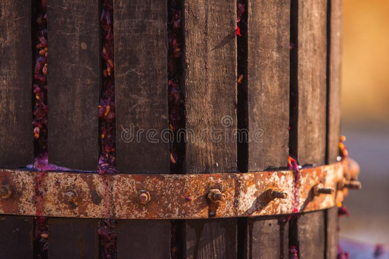 Grape press machine wooden barrel. Homemade wine production. Grape press machine wooden barrel. Homemade ecological wine production on the farm. the whole royalty free stock photos