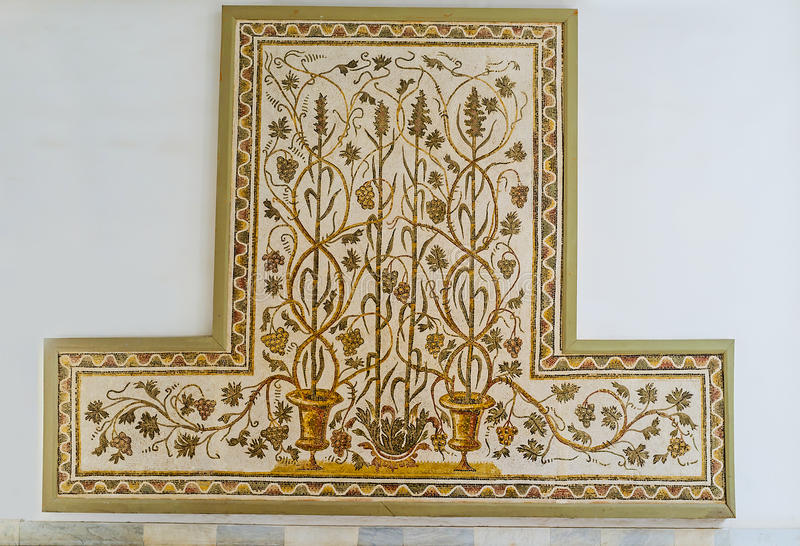 The grape vines. TUNIS, TUNISIA - SEPTEMBER 2, 2015: The ancient mosaic of the grape vines, twisting around other plants in Bardo National Museum, on September 2 stock image