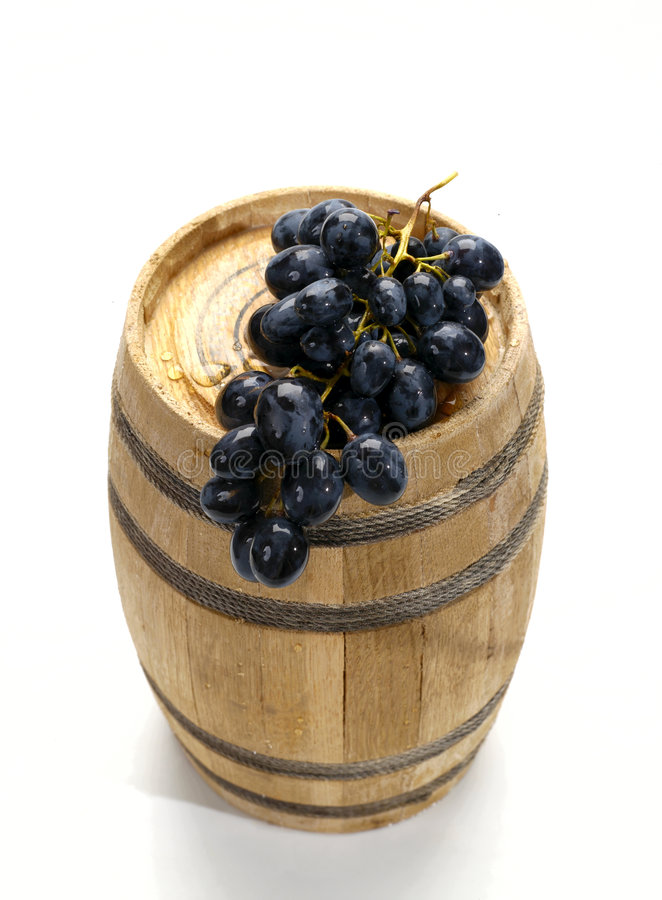 Grape on the wine barrel. Grape on the wood wine barrel. not isolated stock photography