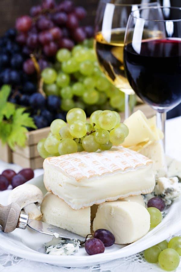 Grape, wine and cheese stock photo