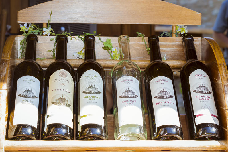 Grape wine of local production in bottles. Church of Saint Barbara royalty free stock images