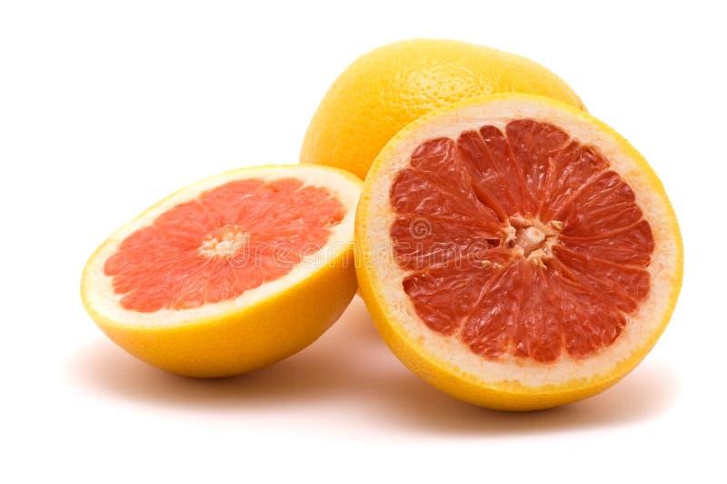 Grapefruit. Sliced grapefruit, isolated on white stock photography