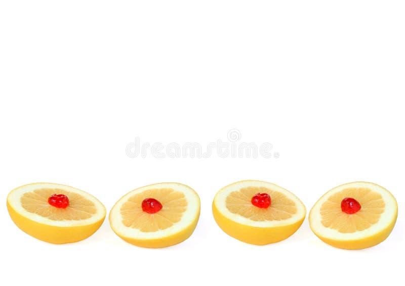Grapefruit with Cherries royalty free stock photo