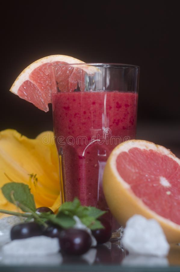 Grapefruit cherry smoothies stock image