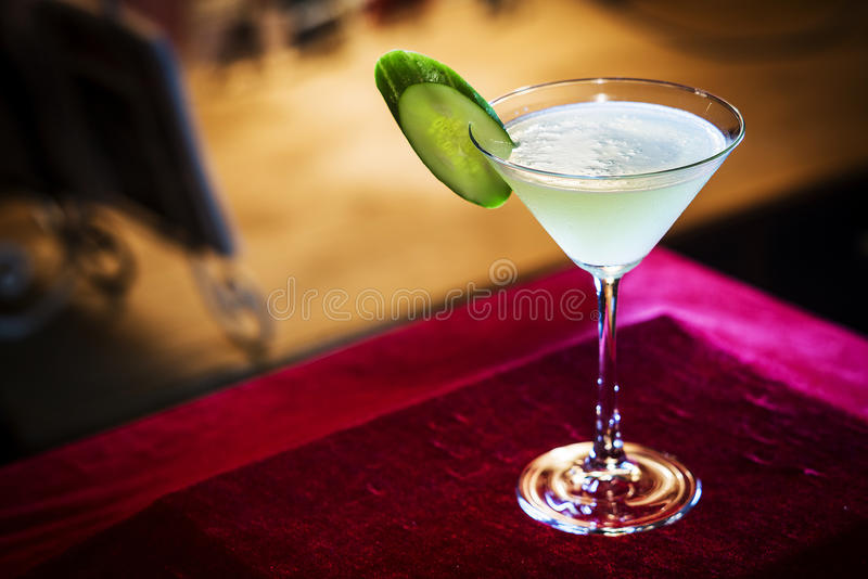 Grapefruit and cucumber martini cocktail drink in bar. At night stock photo