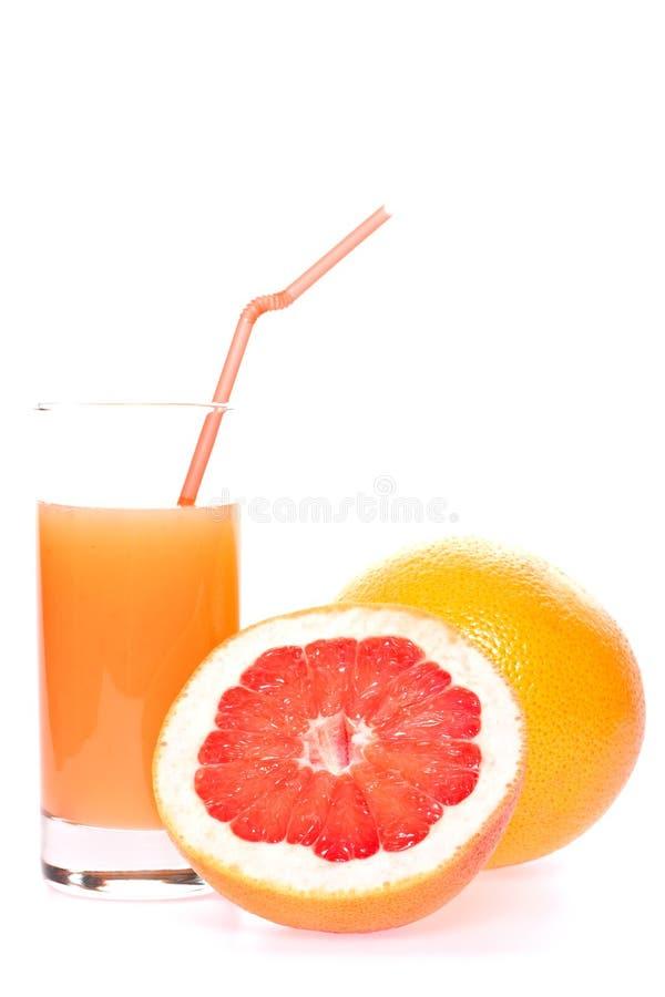Grapefruit en sap in glas royalty-vrije stock afbeelding