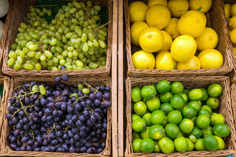 Grapefruit, grapes and limes. For sale at the fruit market stock photography