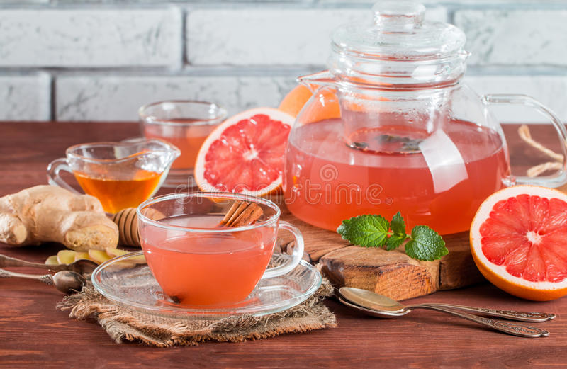Grapefruit herbal tea with ginger and honey stock photos