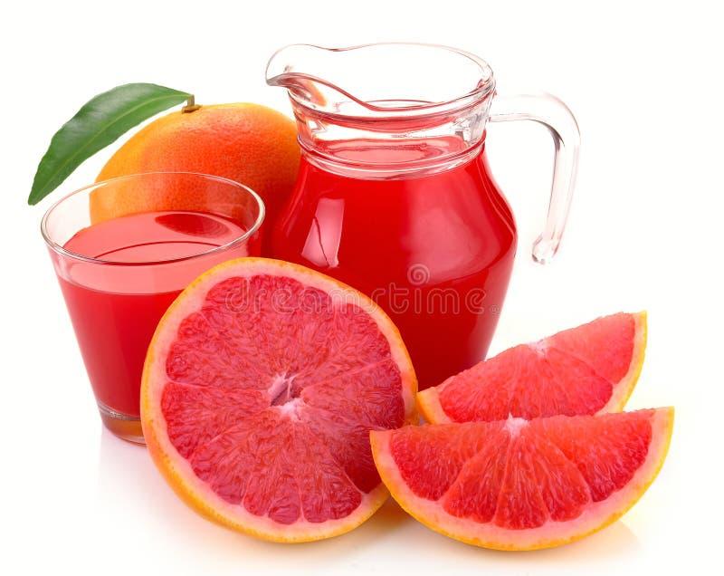 Grapefruit juice en fruit stock afbeelding