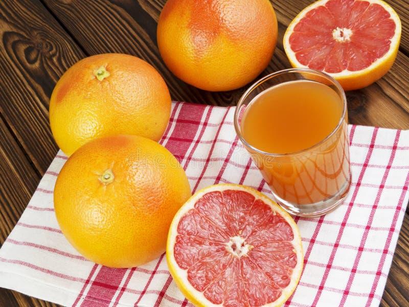 Grapefruit juice in glass royalty free stock image